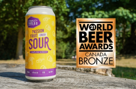 a can of passion fruit crush sour with a bronze award