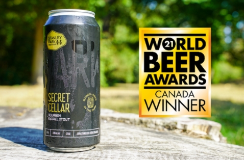 a can of stanley park bourbon barrel stout with a gold award