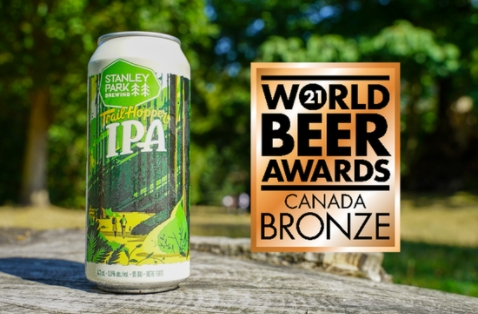 a can of trail hopper ipa with a bronze award